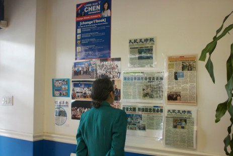 A volunteer reads Chinese newspaper articles featuring Scarborough-Agincourt PC candidate Liang Chen at the campaign office.