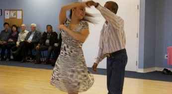 Dance instructor, Maria Ilyukhina, dances with one of the studio's attendees on Saturday's event.