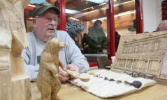 Wilfred Meadus displays a few of his intricate carvings during Saturday's festival.