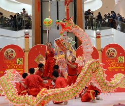 Members of Wushu International College perform the dragon dance Sunday, the eve of the lunar New Year. The dragon looks frightening but is said to have a good nature.