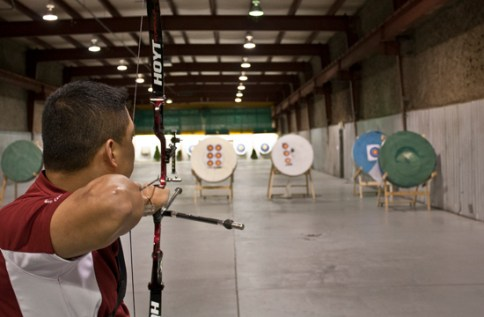 Cruspin Duenas, 26, taking aim at the targets. He starts by shooting close targets for warm up and then shoots 70 metres for the rest of his shots. On a good day he shoots about 200 arrows.