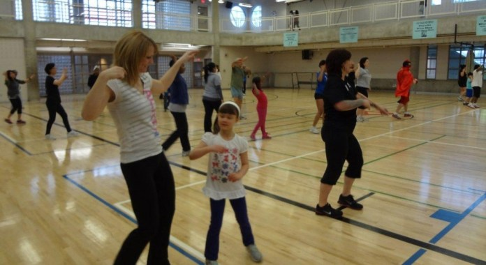 Amy and Kaitlin Gallagher keeping active while participating in the Family Zumba.