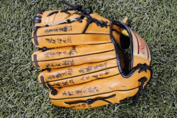 Omar Vizquel's batting practice glove decorated with the signatures of a Little League team from Japan.