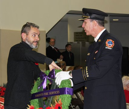 Toronto Fire Department places wreath to honour veterans and fallen soldiers.