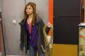 Karen Truong holds a customer's snake.