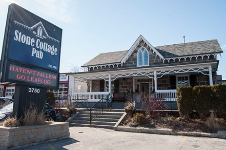 The Olde Stone Cottage Pub, a historical site with great food, and a beautiful sun-filled patio.