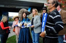 Dignitaries help cut the ribbon at the Oct. 20 unveiling of the Warden Underpass Mural.