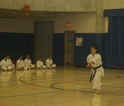 Rosemarie, a purple belt, demonstrates a Karate stance.