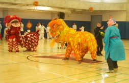 A dancer performing alongside the dragons.