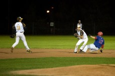 Damien Mills breaks up a double play with a hard slide into second in the bottom of the third inning.