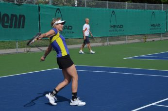 Woman enjoying herself at the Thorncliffe Park Tennis Club during the grand re-opening.