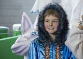 A child who will participate in the Santa Claus Parade.