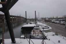 Looking east along the Keating Channel, the William Rest tugboat and the new spud barge are docked for the winter.