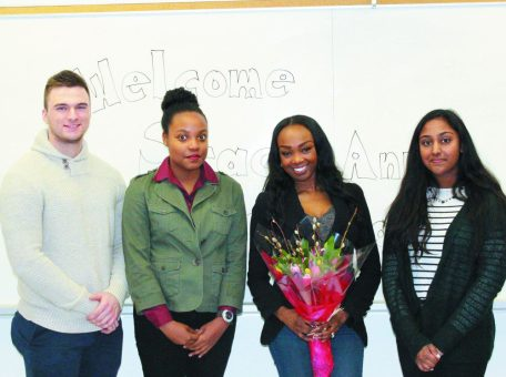 Students pose with Stacy-Ann Buchanan after an interview.