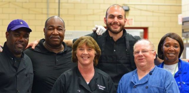 Daniel Giusti with cafeteria staff workers