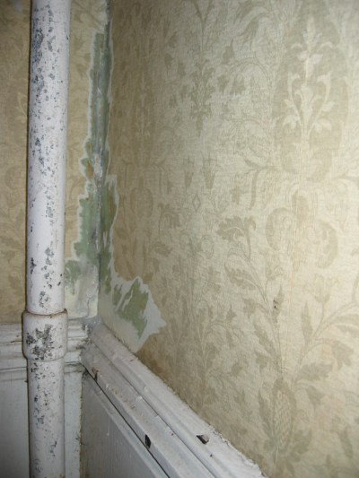 How to repair a crumbling corner of two plaster walls behind an old cast iron steam pipe ...