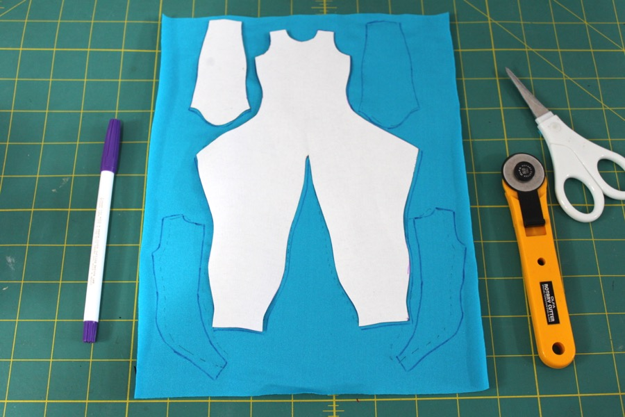 Print out superhero suit pattern, cut out, and trace onto blue spandex.