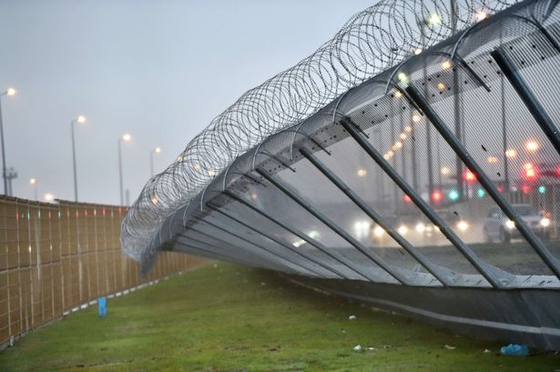 Calais-fence-blown-down