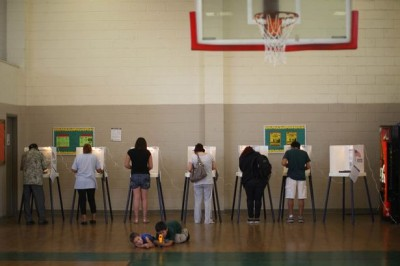 People vote at a school during the U.S-1428758. presidential election