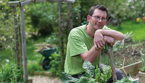 Rob Hopkins in his garden. Photo: Jim Wileman