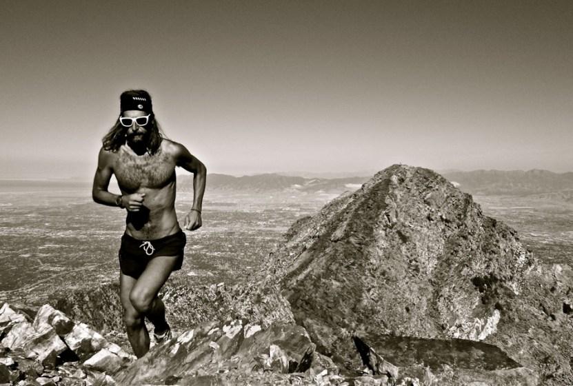 picture of Anton Tony Krupicka summiting twin peaks in salt lake city
