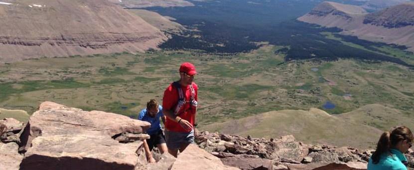 picture of matt williams climbing to the top of kings peak utah