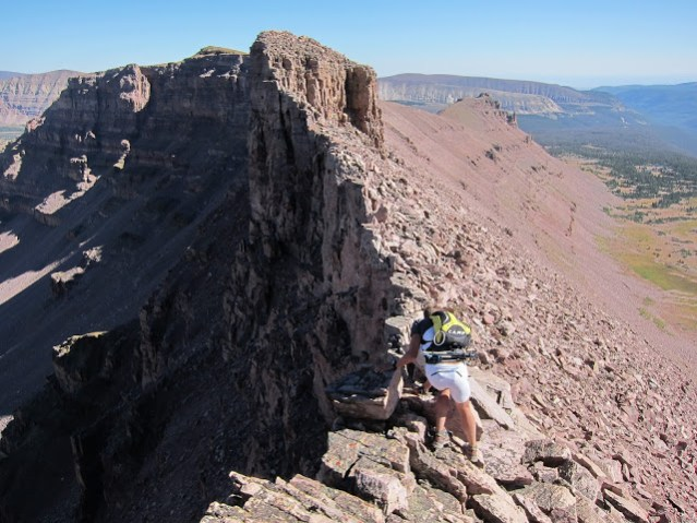 Common ground throughout the Uintas above elevations of 12,000 ft. Tom Goth navigates down East Lovenia, peak #5