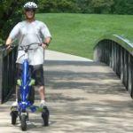 electric three wheeled personal transportation vehicle on boulder creek path