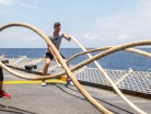 Chief Petty Officer Second Class (CPO2) Monika Quillan (left) and Sub-Lieutenant (SLt) Marc Flynn (right), of Her Majesty's Canadian Ship (HMCS) ATHABASKAN, perform rope drills as part of a physical fitness class on the flight deck, while on Op Caribbe, May 2, 2015 Operation Caribbe is Canada's contribution to Operation MARTILLO, a US Joint Interagency Task Force South (JIATF-S) operation.  JIATF-S is a US National task force responsible for conducting interagency and regional security operations and facilitating the interdiction of illicit trafficking of drugs, weapons, money and personnel. Image By: Corporal Anthony Chand   Formation Imagery Services   © 2015 DND-MND Canada