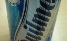 Lata grande de cerveza Quilmes con alcohol