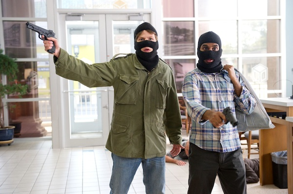 Nick (Jesse Eisenberg) and Chet (Aziz Ansari) rob a bank in '30 Minutes or Less'