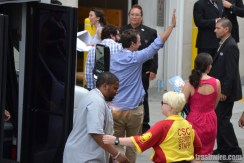 Seth Meyers, Keenan Thompson and Bobby Moynighan wave at fans at Comic Con 2013