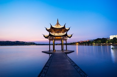 chinese ancient pavilion with sunset at the west lake in hangzhou