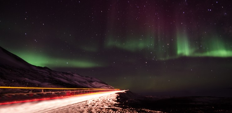 Trucks passing under Auroras