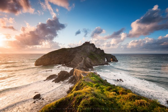 Windy sunset at the island of Gaztelugatxe viewing the ancient church