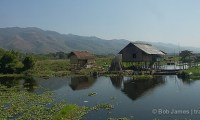 "Inle Lake is filled with ""floating villages"" with houses built on stilts"