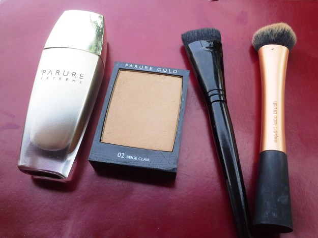 Tools with which I un-layer (L-R): Guerlain Parure Extreme Foundation liuid, Guerlain Parure Gold Foundation compact, Illamasqua Blush Up Brush, Real Techniques Expert Face Brush