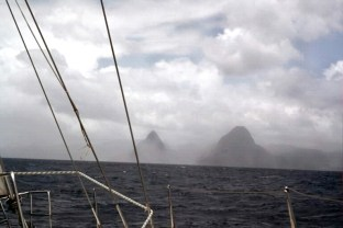 The Pitons rising from the clouds