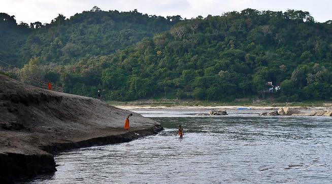 monks on mekong river