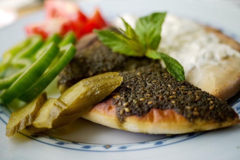 Manakish with za'atar baked into the top of the pita bread