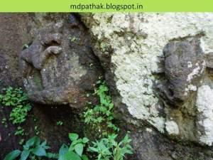 ganesha carvings at side of steps at kothaligad