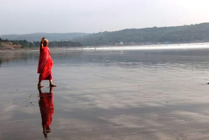 clean sea beach of ladghar my mother walking