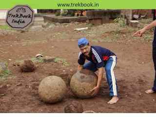 lifting spherical stones at jarandeshwar