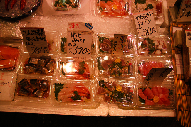 Lots of nice freshly cut Sashimi like slices are on sale at this stall