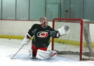 Carolina_Hurricanes_Cam_Ward_glove_save_puck