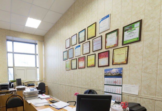 Certificates mounted on an office wall