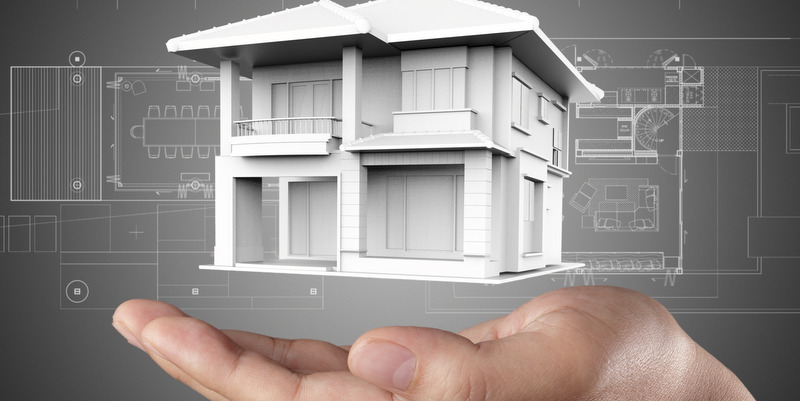 The house in hands on blue print