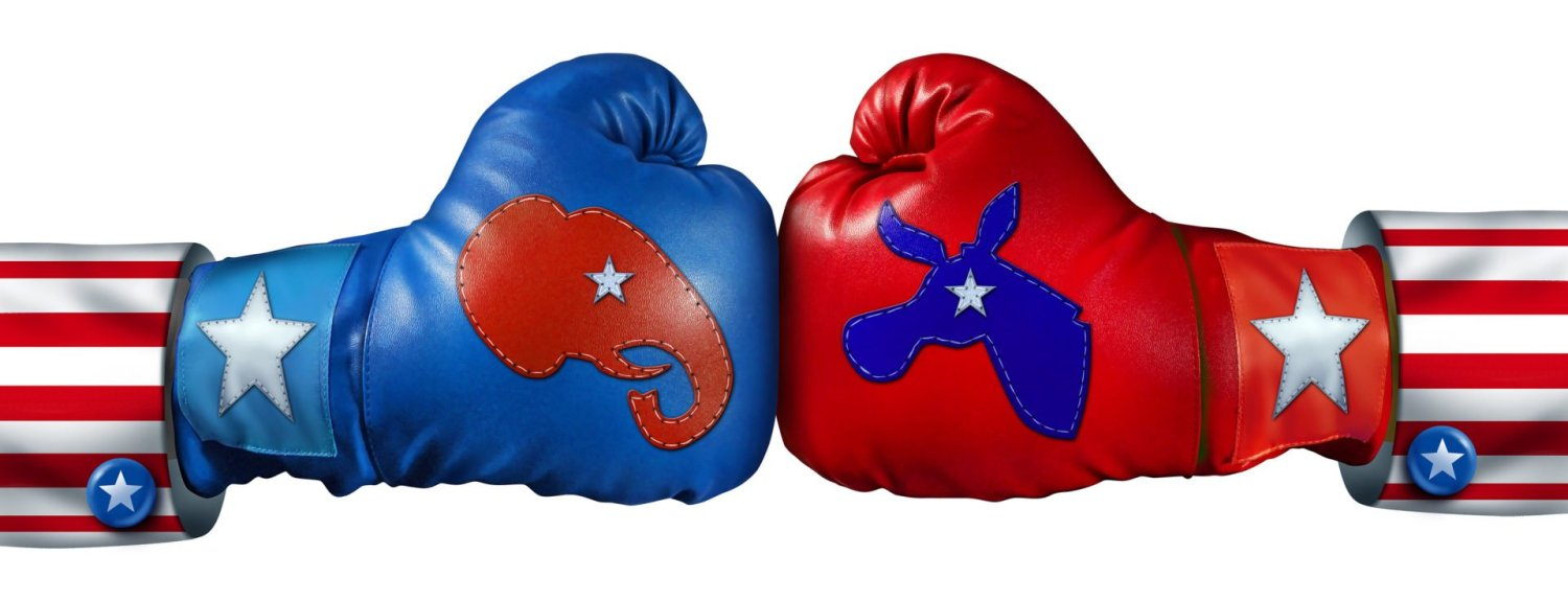 American election campaign fight as Republican Versus Democrat represented by two boxing gloves with the elephant and donkey symbol stitched fighting for the vote of the United states citizens for an election win.