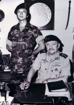 werbell in asia with asian military guy