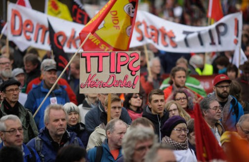 Thousands of demonstrators protest against the planned Transatlantic Trade and Investment Partnership, TTIP, and the Comprehensive Economic and Trade Agreement, CETA, ahead of the visit of United States President Barack Obama in Hannover, Germany, Saturday, April 23, 2016. (AP Photo/Markus Schreiber)